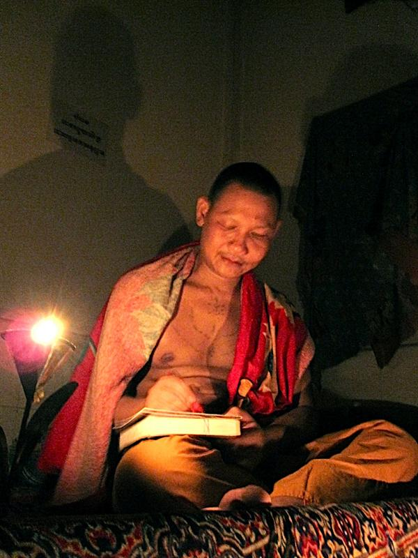 My new monk friend. Because I'm with my teacher friend, I was allowed to hang out in this monk's place. Here is doing my astrology.