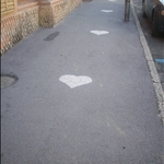 The little hearts the school children follow so they dont get lost.