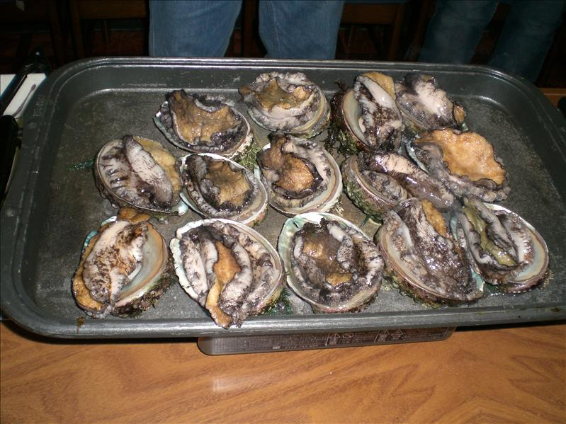 Live abalones on the grill...Ouch!