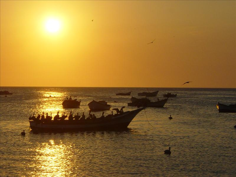 Sunset, fisherboat with Pelicans