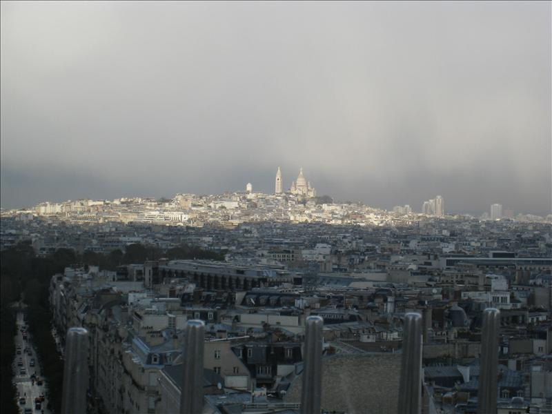 Sacre Coeur covered by rain clouds in the distance