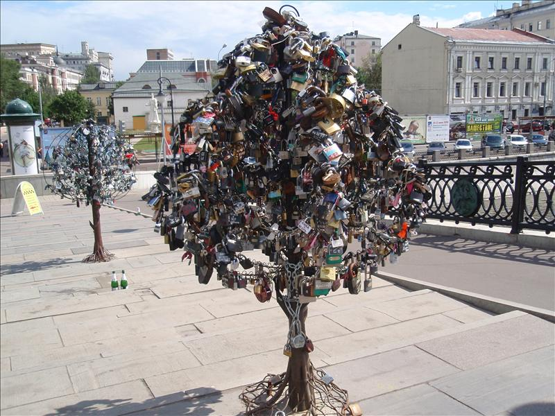 Newly-married couples mark their bond by locking a padlock to these 'trees' on a bridge over the river.  At the time, I assumed they were locks for sale.
