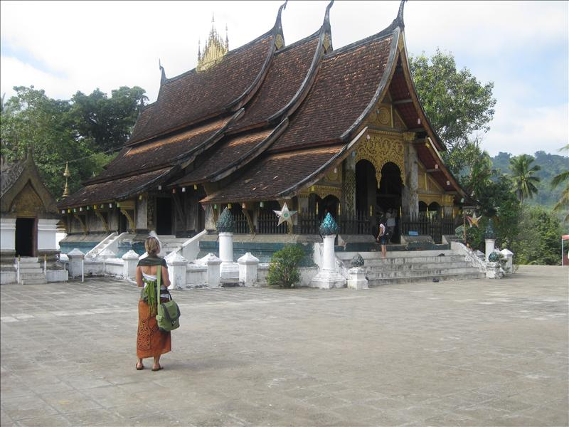 Sylvia in front of Golden City Temple (Wat Xieng Thong)