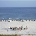 a wedding procession begins on the beach