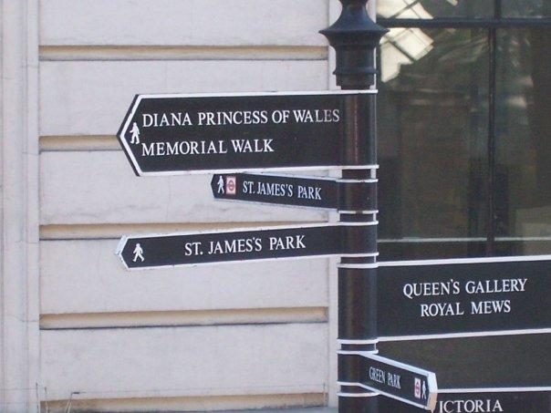 Street signs showing Princess Di's Memorial Walk; St. James Park; and Queen's Gallery and the Royal Mew.