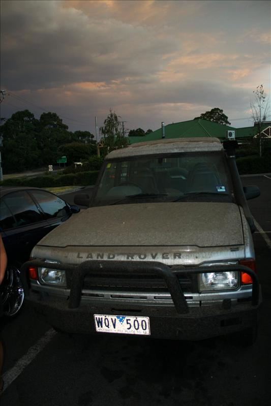 Vicky, after our drive away from the bush fires. Covered in Black Rain!