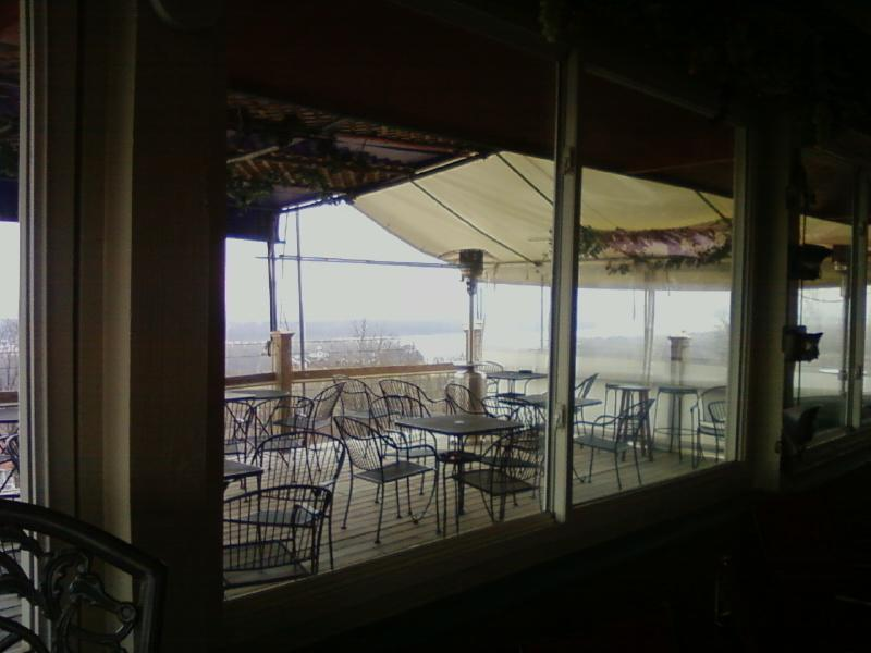 enclosed and deck tables for $6 glasses of wine