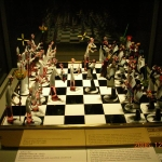 a funny chess set displayed in a Corning glass museum