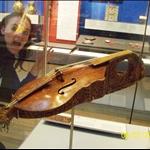 Adri marvels at the violin.JPG