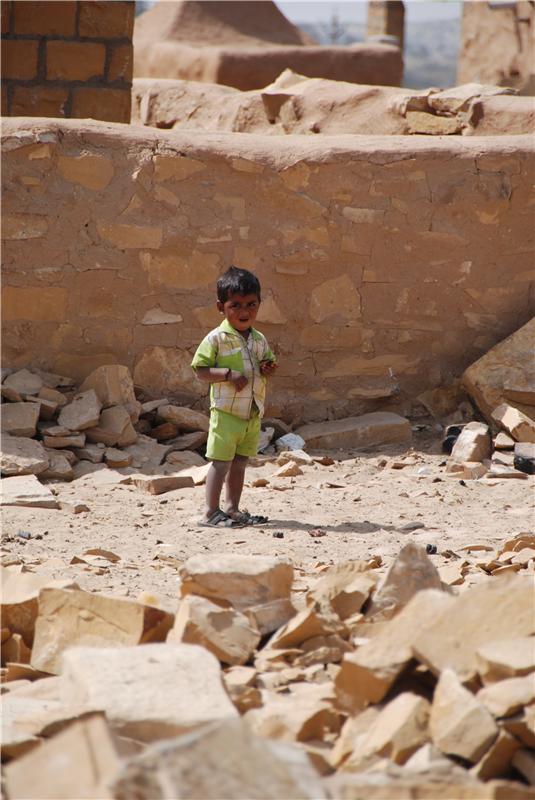 Baby in desert village