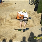 Guy playing on the sand coach.JPG