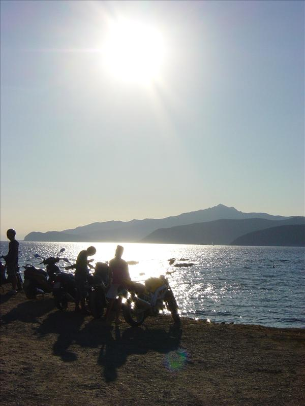 Sunset Elba scooters on the beach