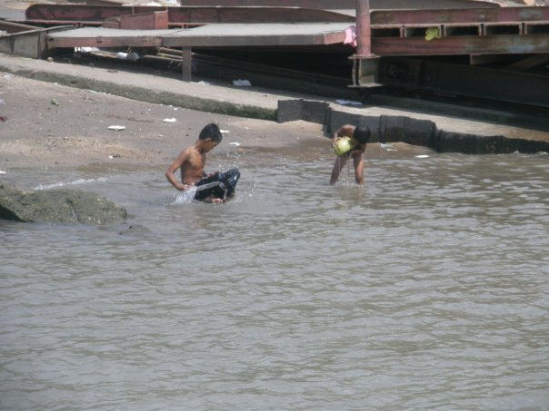 Boys playing in the river where we put our bus on the ferry on our way to Phnom Penh.