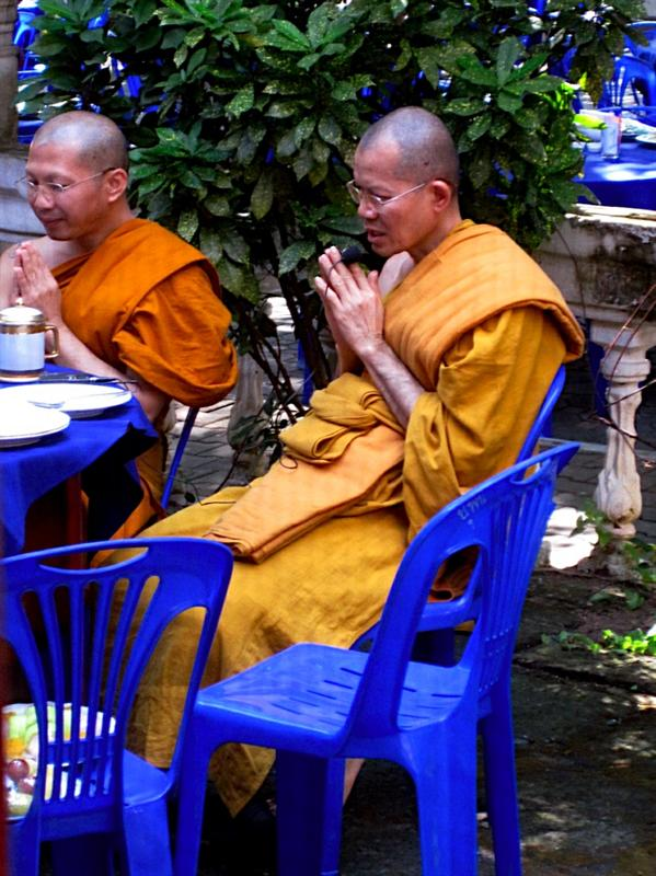 The Abbot, chanting prayers before eating lunch.