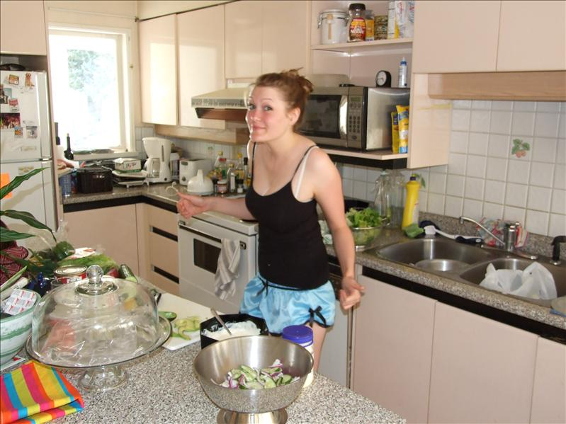 Anne prepares salad for james' arrival home