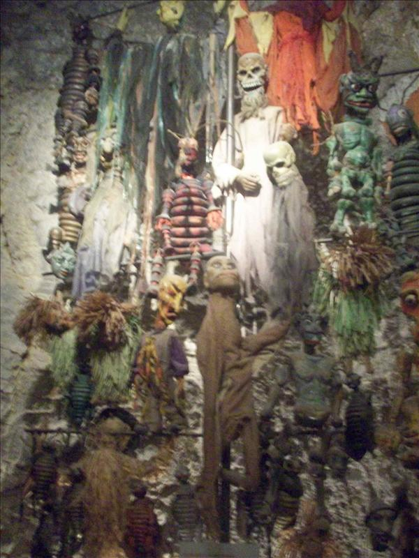 A wall of old marionettes