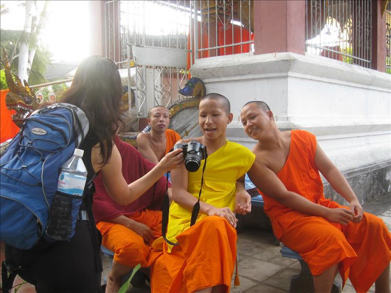 Novice monks enjoy having their picure taken.