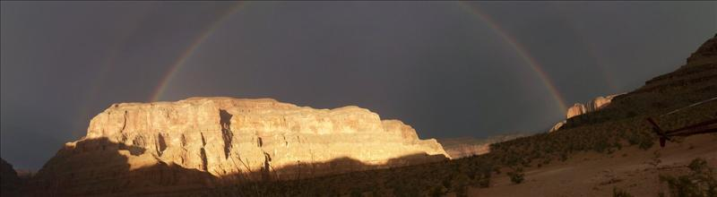 tis panoramic shot could not capture the magic of a double rainbow set against a thunderous sky