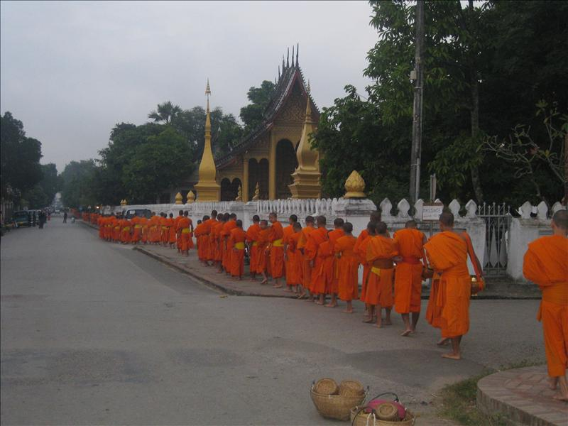 Monks in line to collect their alms