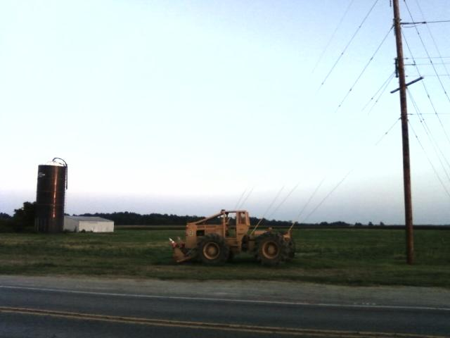 a piece of construction equipment sits roadside