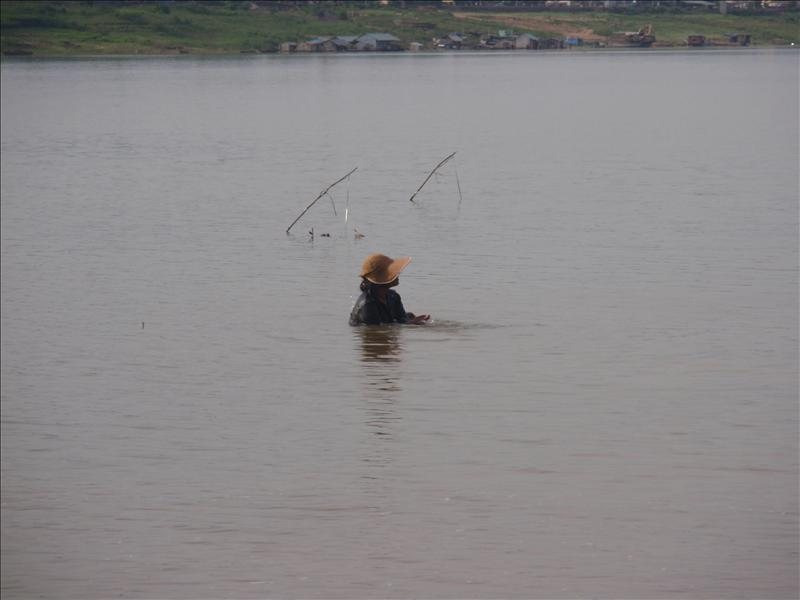 Taking a bath in the Mekong