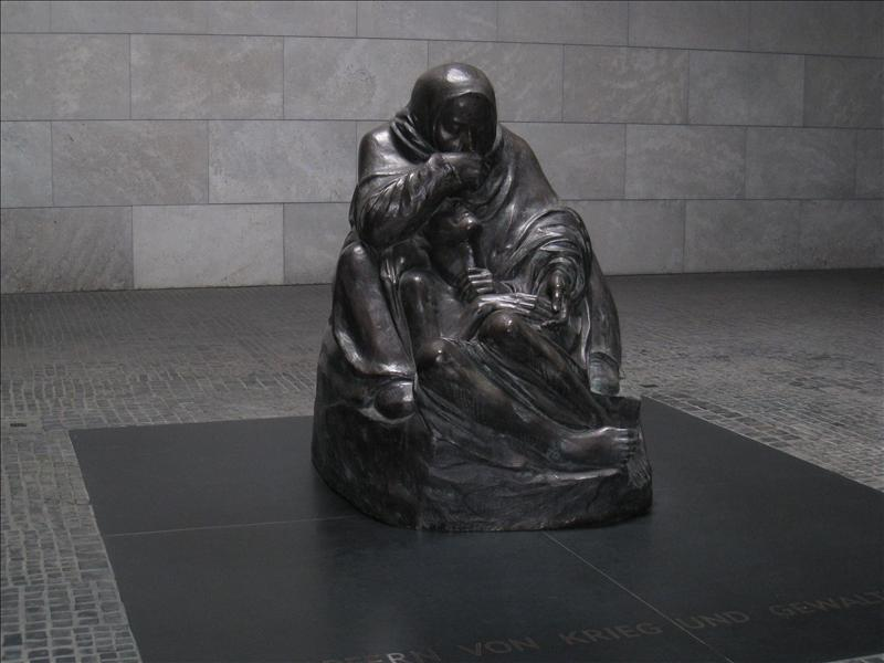 Memorial in a building with a hole over it, so when it rains its like the woman's tears...