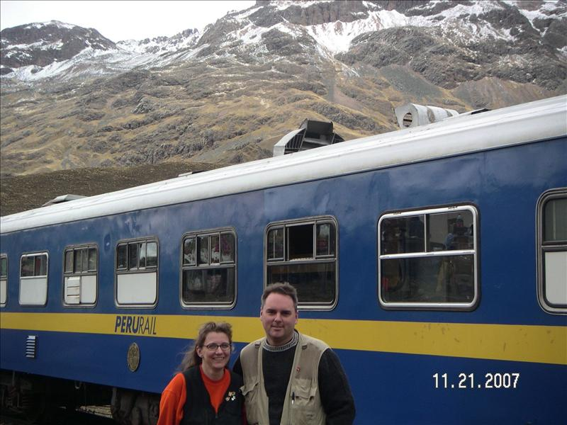 Me and wife: highest point in Andes for this train ride. Andes in the background.