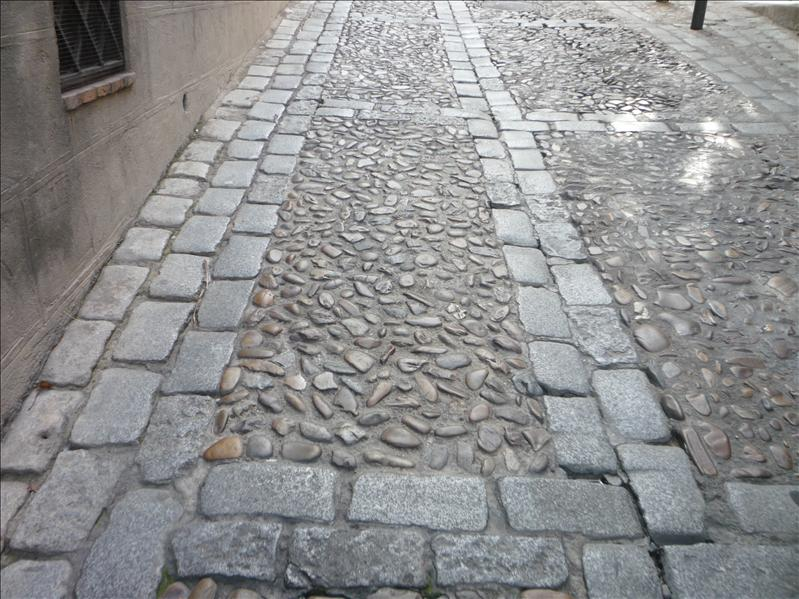 Love the cobble streets of this city.  Like icing on a cake, it perfects the antiquy feeling of the city.