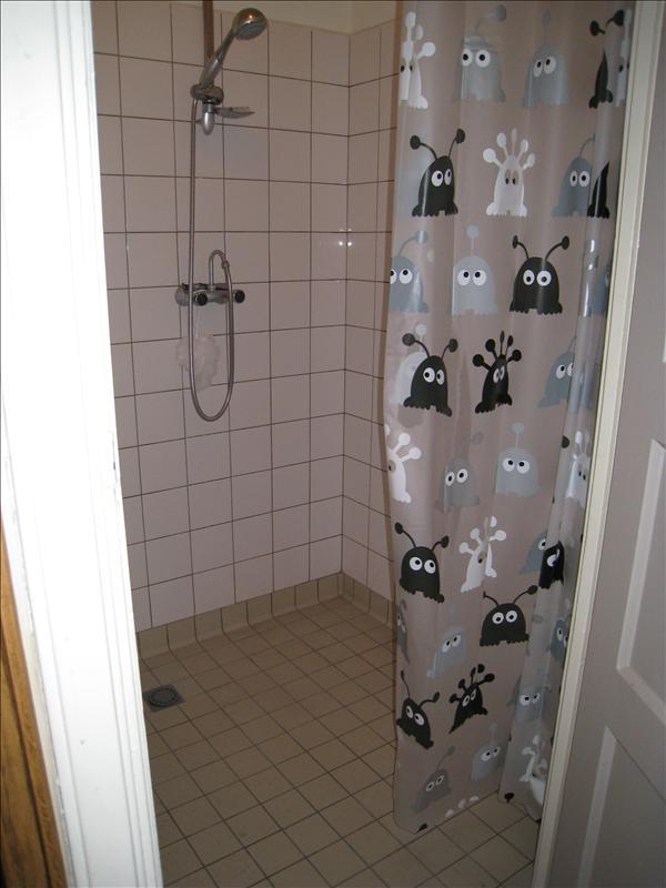 Bathroom...all tile floor with a drain...