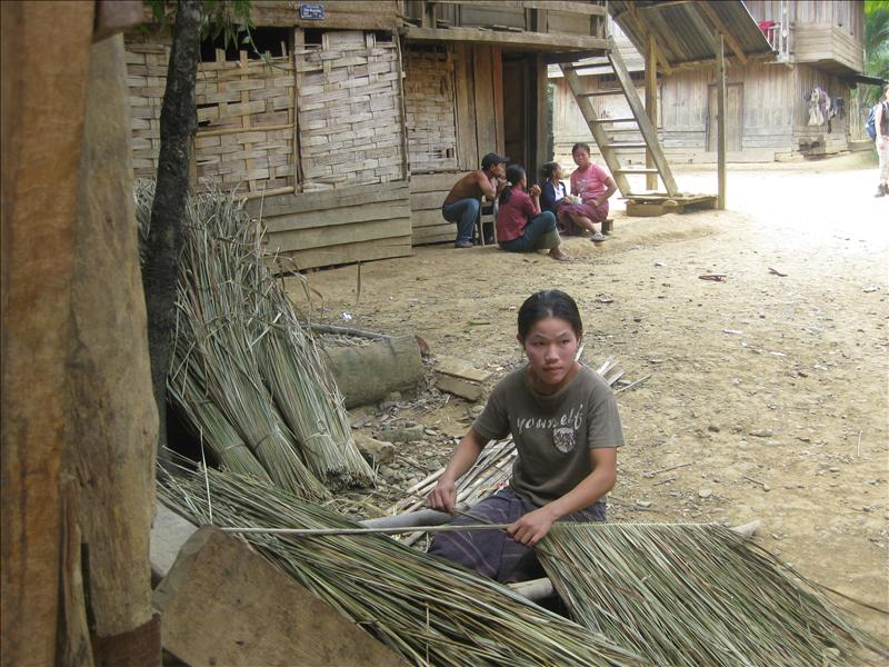Women working on palm thatches for the huts