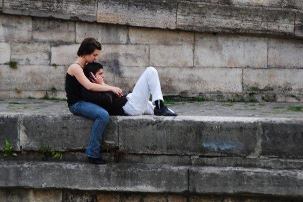 couple by the Seine River