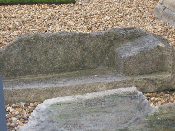 This is a medieval limestone coffin with shaped beds found in the Abbey precincts.