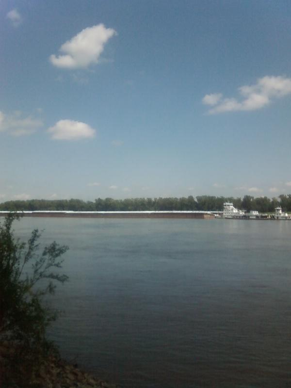 a full view of the barge and towboat