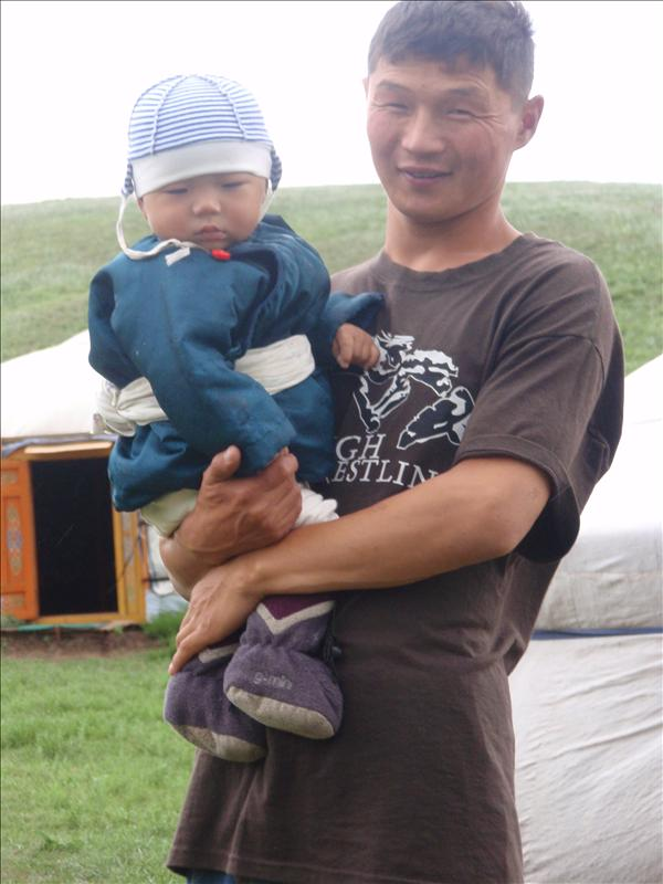 Mendee with his youngest son in national costume