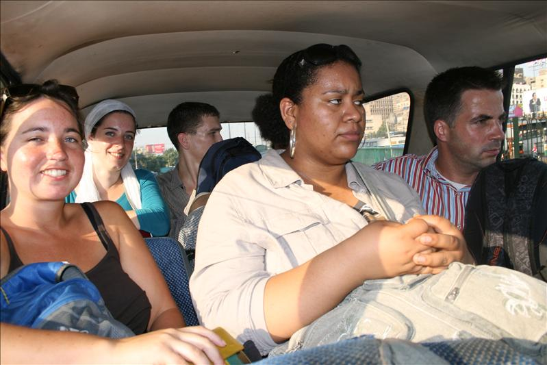 ...8 people in a taxi???