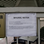This sign says that the hot tub uses mineral water, which comes out greenish-blue.