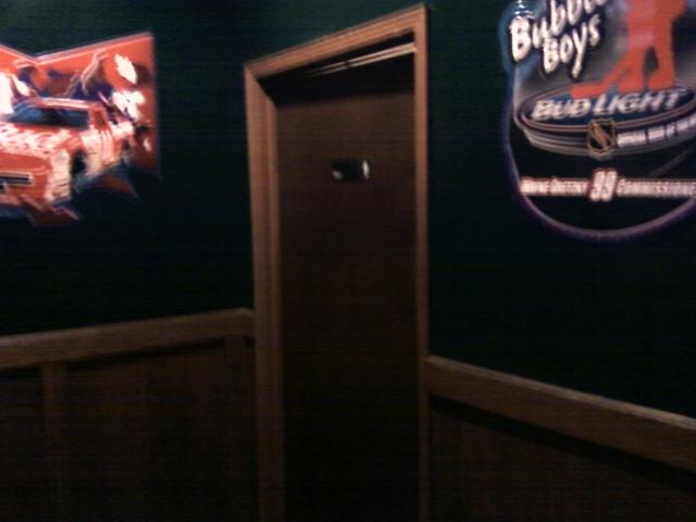 mens bathroom door is sports bar grade, meaning it is made to be destroyed by angry sports customers