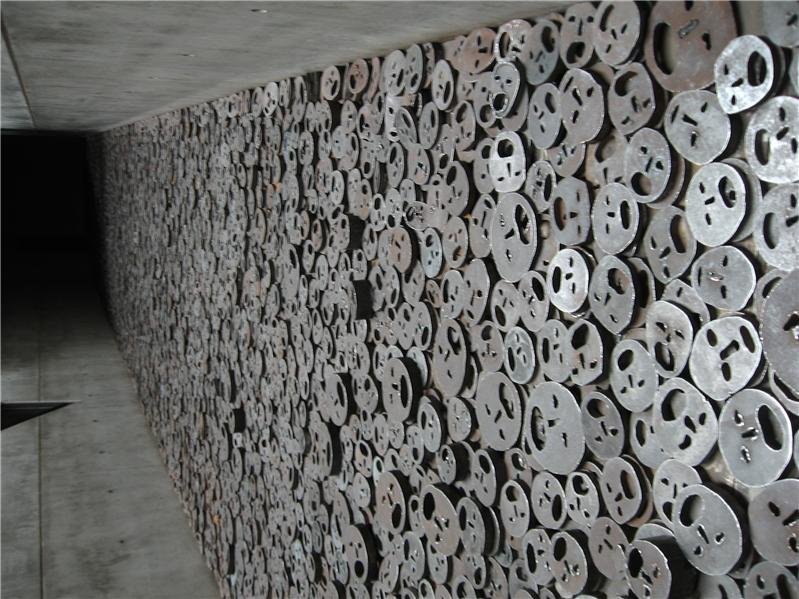 Amazing work of art, to remember the Holocaust, you walk on the sliding metal faces...