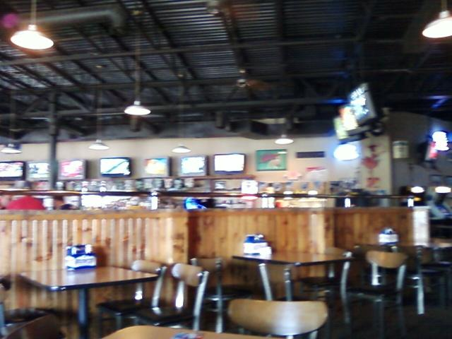 O'Aces, a full bar where the television sets sit