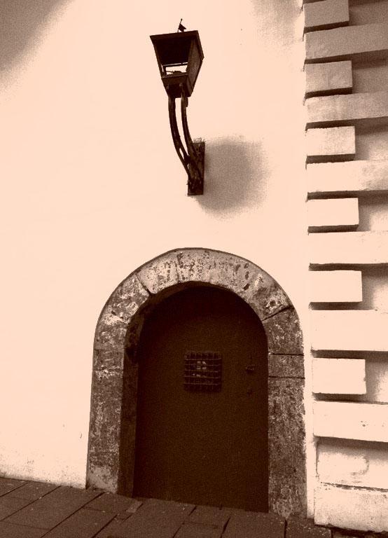 Turn of the century street lamp and door.