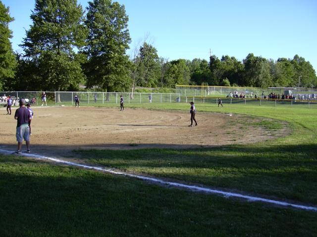 outfielders wait for the batter to hit the ball