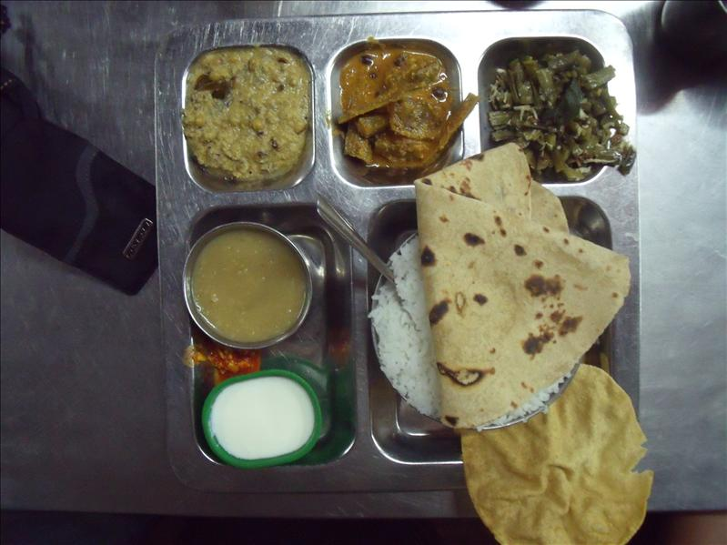 Lovely thali, aesthetically challenged rectangular trays.