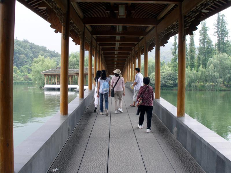 Strolling around the lake with our local tour guide. Next time we are going to spend at least one night here.