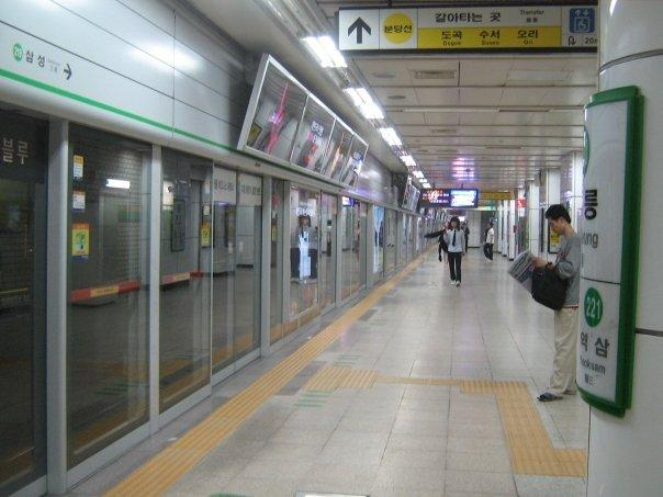 korean subway.  see how there's sliding doors there to prevent stuff from falling onto the tracks?? genious!