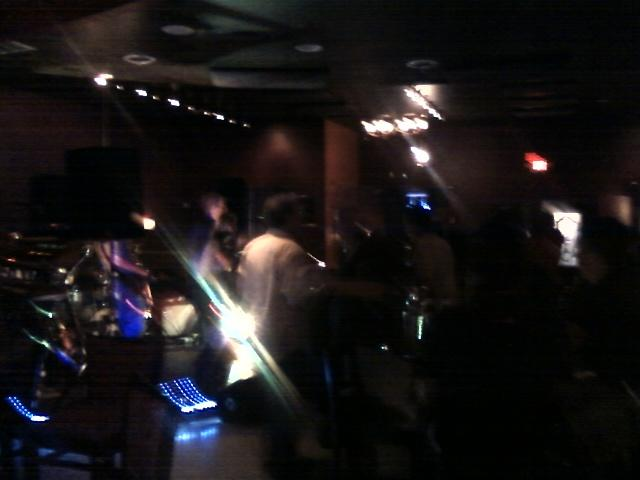 a shot of the band from the bar is not so good