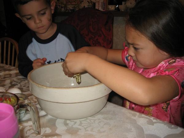 Xander and Maddie helping making Ava's birthday cupcakes