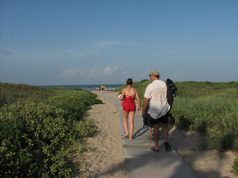 Alexis and Tom walking to beach