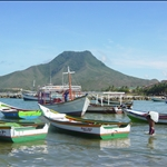 Fishermans boats in front of the island mountain