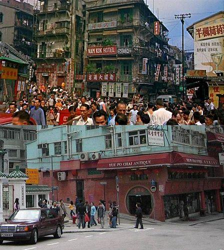 "Upper photo--view of Hollywood Rd. area (movie""World of Susie Wong was being shot at the time);Lower photo --- Nowadays Hollywood Rd."