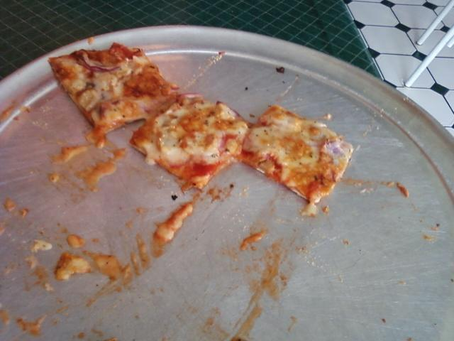 what we couldn't finish of a 12 inch pizza, notice the square cut pieces